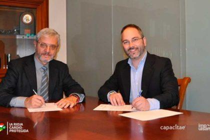 Firma del convenio entre el Dr. Lozano (SEC) y José María Marcolaín (Capacitae)